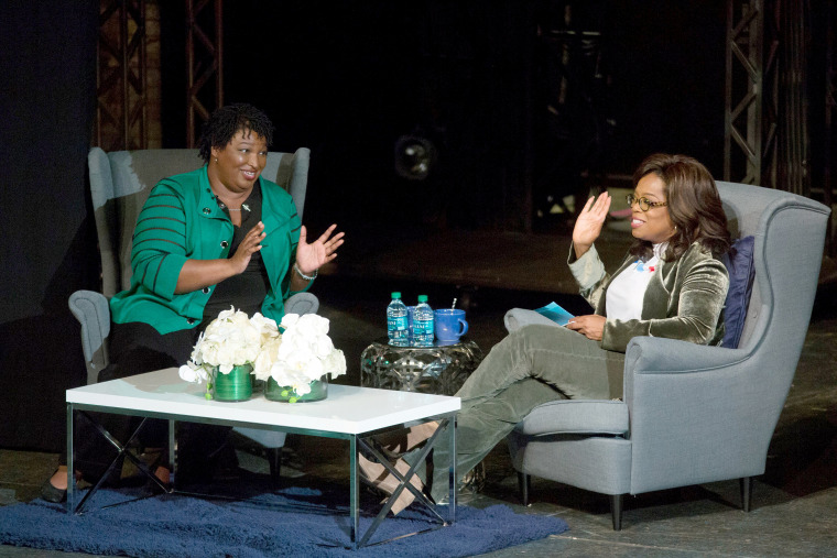 Image: Oprah Winfrey takes part in a town hall meeting with Stacey Abrams in Marietta