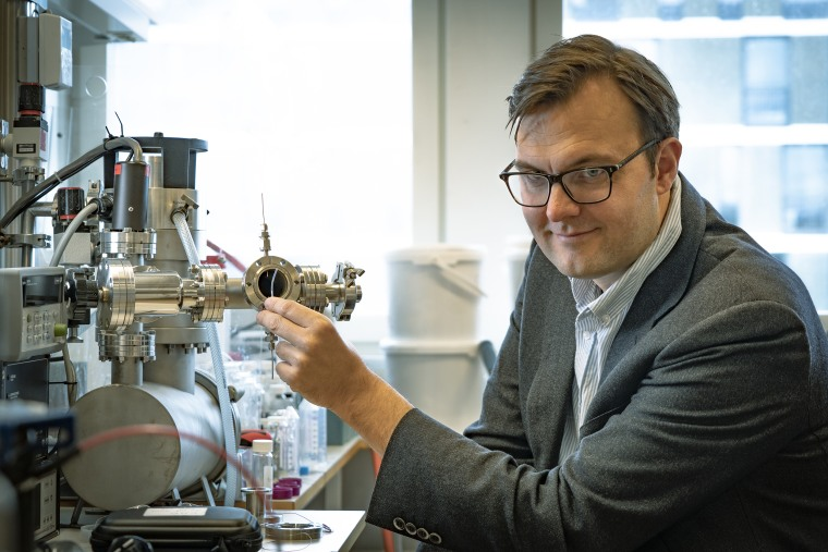 Image: Professor Kasper Moth-Poulsen holding a tube containing the catalyst