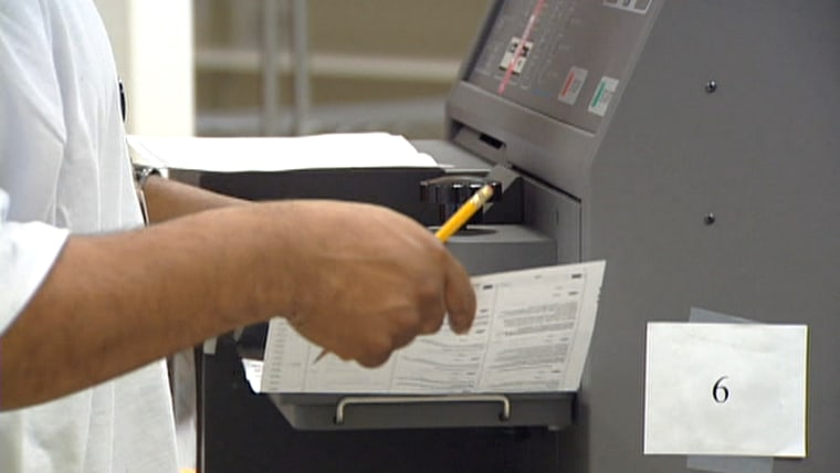 A paper ballot being stamped that has been filled out and sent in by a Oregon resident.