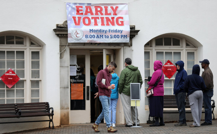 Image: Early voters arrive at a polling station in Athens, Georgia