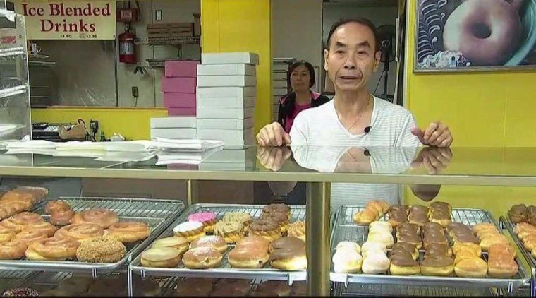 The community of Seal Beach is helping a donut store owner spend more time with his wife who suffers from a brain aneurysm.