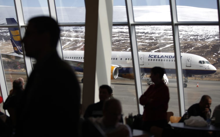 Image: An Icelandair airplane sits on the tarmac as travelers wait for a flight inside the Akureyi Airport
