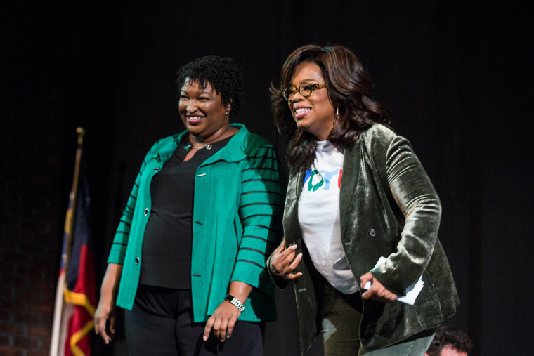 Image: Oprah Winfrey and Georgia Democratic Gubernatorial candidate Stacey Abrams greet the audience during a town hall style event at the Cobb Civic Center