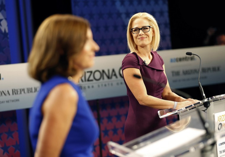 Image: U.S. Senate candidates, U.S. Rep. Martha McSally, R-Ariz., left, and U.S. Rep. Kyrsten Sinema, D-Ariz., prepare their remarks in a television studio prior to a televised debate,