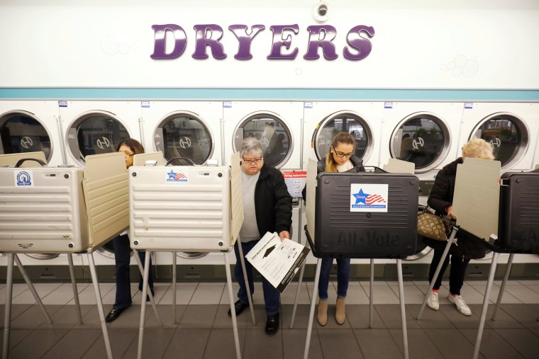 Image: Voters cast their ballots in the midterm election at Sunueva Laundromat in Chicago