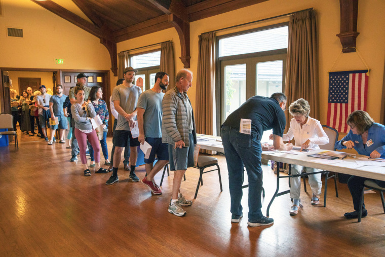 Image: Voters line up to cast their ballots at Neighborhood Congregational Church on the morning of the midterm elections, in Laguna Beach