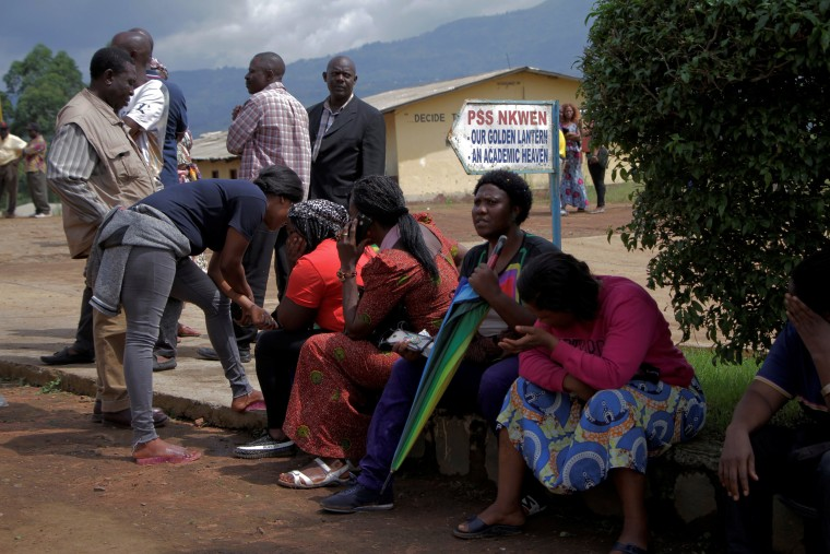 Image: Parents await for news of their children at a school where 79 pupils were kidnapped in Bamenda