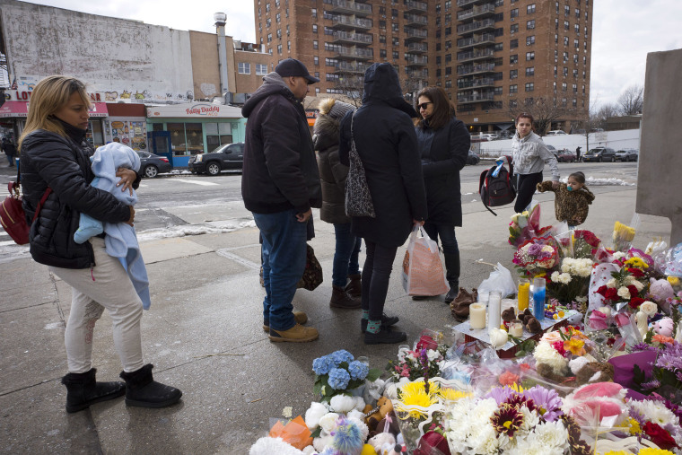 Image: People gather at a sidewalk memorial for two children who were killed the previous week when they were struck by a car driven by a woman who likely had a seizure behind the wheel, in the Park Slope neighborhood of the Brooklyn borough of New York.