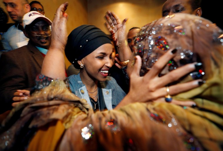 Democratic congressional candidate Ilhan Omar is greeted by her mother-in-law after appearing at her midterm election night party in Minneapolis on Nov. 6, 2018.