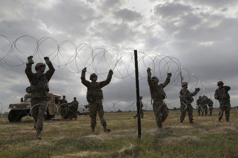 U.S. Army soldiers from Ft. Riley, Kansas string razor wire near the port of entry at the U.S.-Mexico border in Donna, Texas