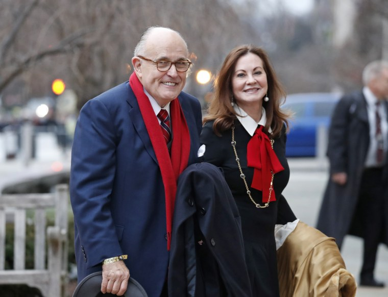 Rudy Giuliani and his wife, Judith Giuliani, arrive for a church service at St. John's Episcopal Church across from the White House on Jan. 20, 2017.