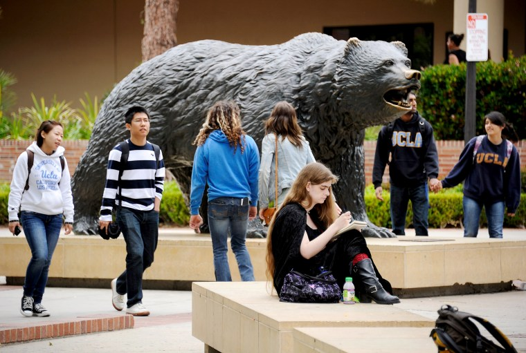 Students sit around the Bruin Bear statue during lunchtime on the campus of UCLA on April 23, 2012 in Los Angeles.
