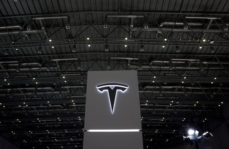 Image: A Tesla sign is seen during the China International Import Expo (CIIE), at the National Exhibition and Convention Center in Shanghai