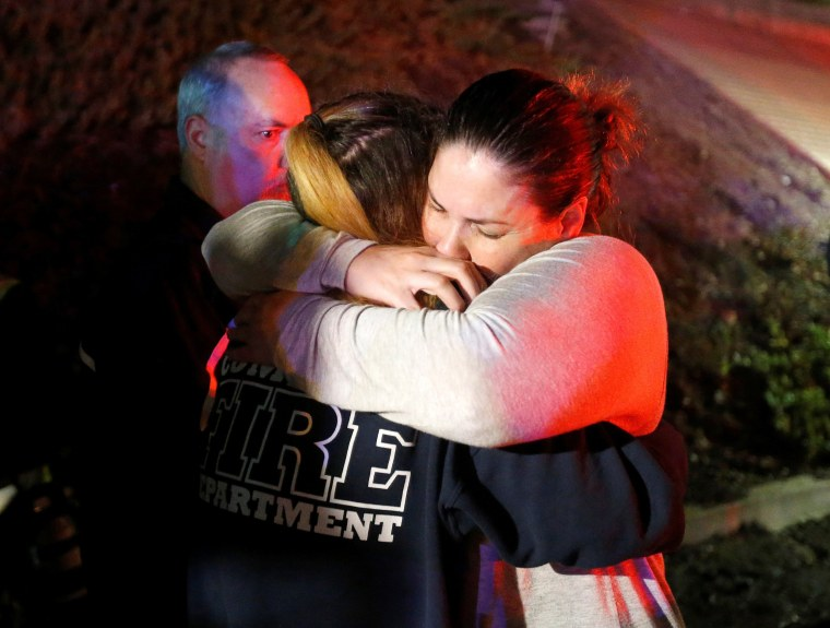 People hugged each other outside of the Borderline Bar in Thousand Oaks