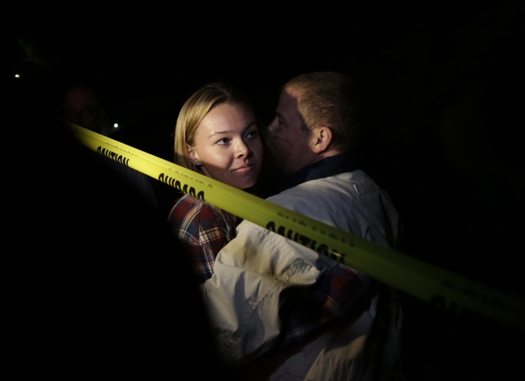 Teylor Whittler is hugged by her father after the shooting at the Borderline Bar and Grill
