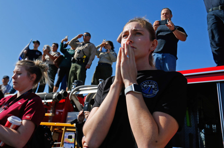 Image: Madison Fuller of Thousand Oaks reacts as she watches from an overpass as a procession for the body of  Sergeant Ron Helus, who died in a shooting incident at a Thousand Oaks bar,  drives down Ventura HIghway 101 in Thousand Oaks
