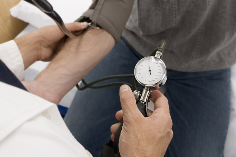 Image: Doctor checking a patient's blood pressure