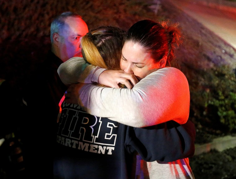 Image: People comfort each other after a mass shooting at a bar in Thousand Oaks