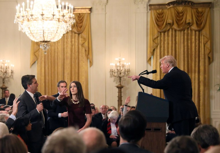Image: A White House staff member reaches for the microphone held by CNN's Jim Acosta as he questions U.S. President Donald Trump during a news conference in Washington