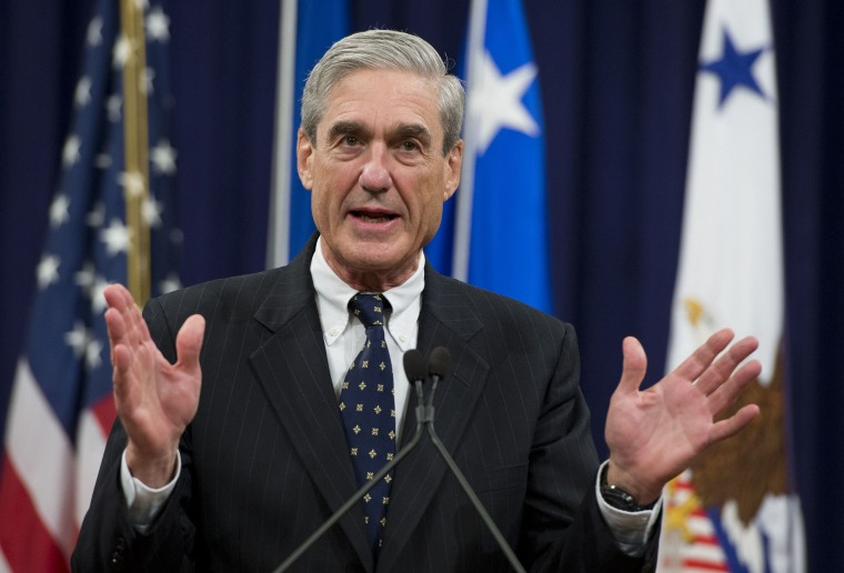 Image: Robert Mueller speaks during a farewell ceremony in Mueller's honor at the Department of Justice