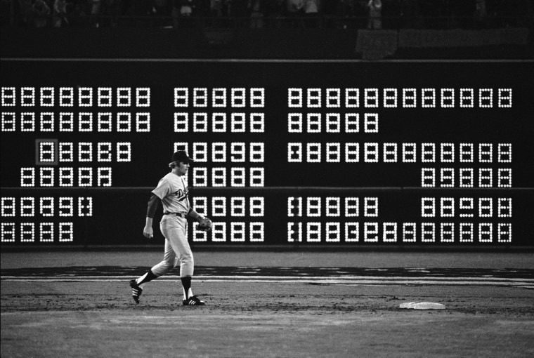 """The scoreboard flashes """"715"""" seconds after Hank Aaron hit his recording breaking 715th home run in 1974."""