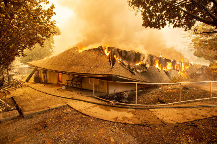 The Feather River Hospital is engulfed in flames as the Camp Fire rages through Paradise, California, on Nov. 8, 2018.