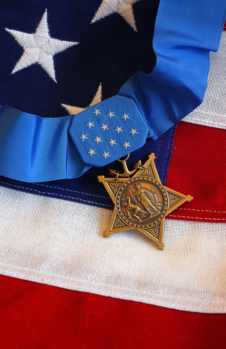 The Medal of Honor rests on a flag.
