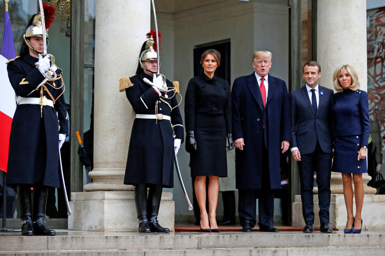 Image: French President Emmanuel Macron and his wife Brigitte Macron accompany US President Donald Trump and first lady Melania Trump as they leave the Elysee Palace in Paris