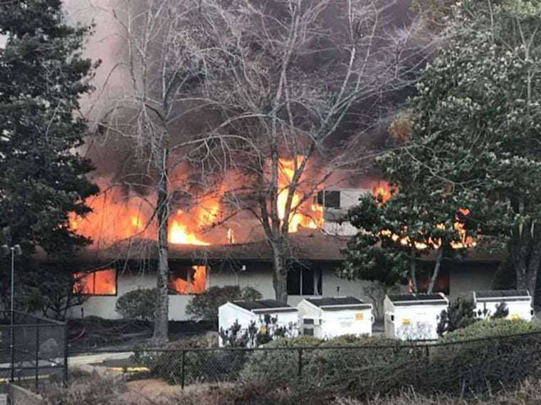 The back of Adventist Health Feather River Hospital in Paradise, California, burns as it is overtaken by the Camp Fire.