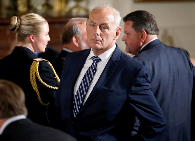 Image: White House Chief of Staff Kelly stands before a Medal of Honor ceremony in the East Room of the White House in Washington