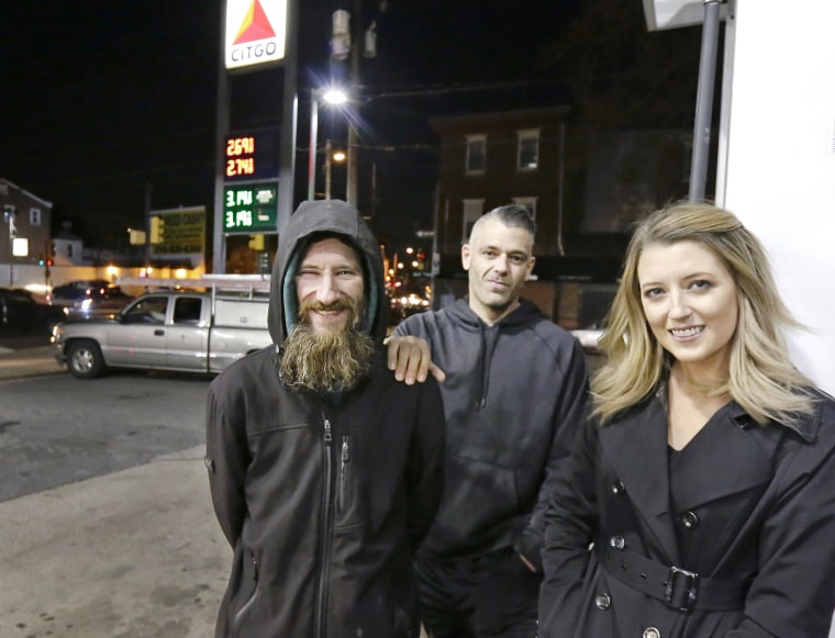 Johnny Bobbitt Jr., left, Kate McClure, right, and McClure's boyfriend Mark D'Amico