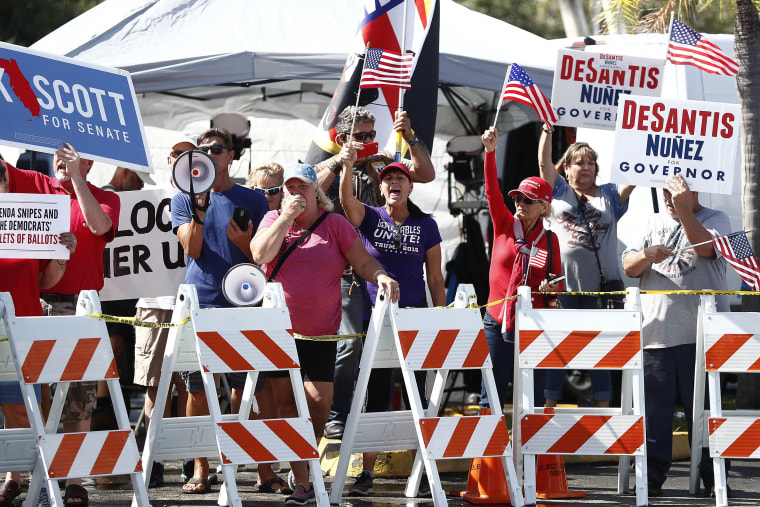 Image: Protesters gather outside of the Broward County Supervisor of Elections office during a recount