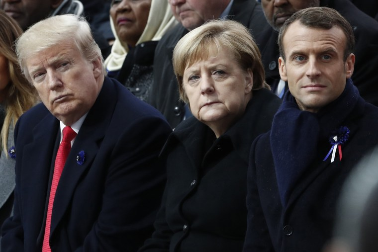 President Donald Trump, German Chancellor Angela Merkel and French President Emmanuel Macron attend a commemoration ceremony for Armistice Day in Paris on Nov. 11, 2018.
