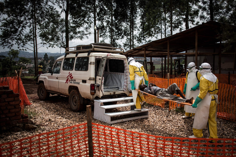 Health workers move a patient to a hospital after he was cleared of being infected with Ebola in the Democratic Republic of Congo on Nov. 4, 2018.