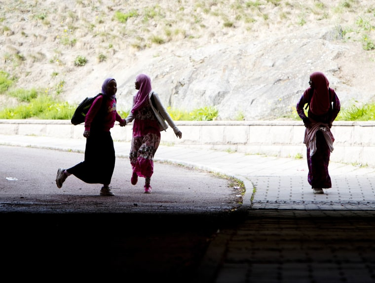 Image: Migrant girls walk through a railway tunnel in Flen, some 100 km west of Stockholm, Sweden