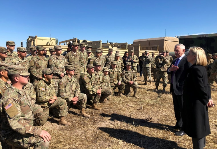Image: U.S. Defense Secretary Mattis alongside Secretary of Homeland Security Nielsen addresses troops at Base Camp Donna in Donna