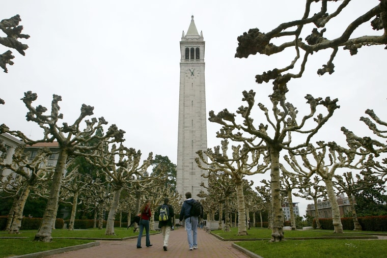 Students walk near Sather Tower on the University of California at Berkeley campus in California.