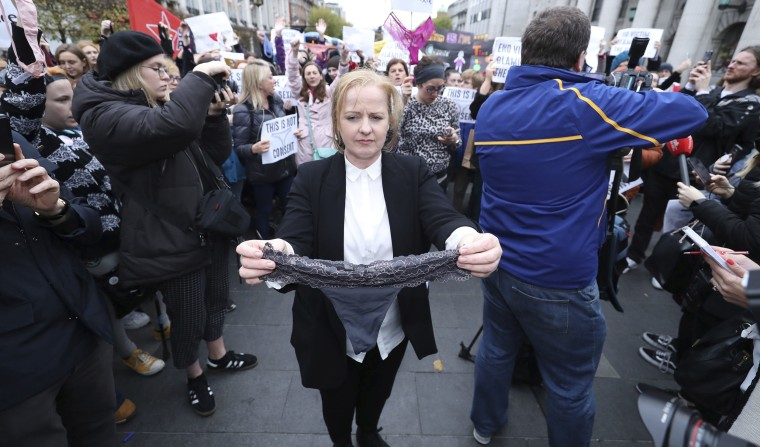Image: Irish lawmaker Ruth Coppinger holds a thong during a protest