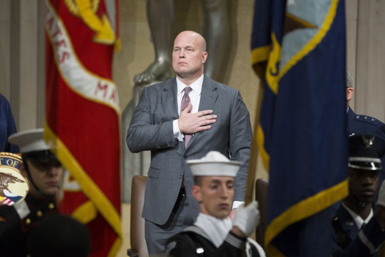 Acting Attorney General Matthew Whitaker observes the presentation of the colors during a Veterans Appreciation Day ceremony at the Justice Department in Washington on Nov. 15, 2018.
