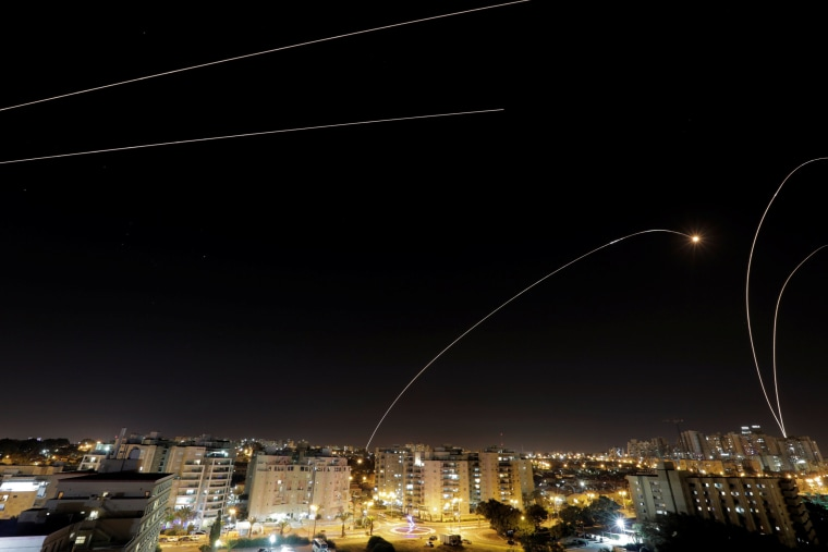 Image: A general view of the Israeli city of Ashkelon, as an Iron Dome anti-missile fires near the Israeli side of the Israel-Gaza border
