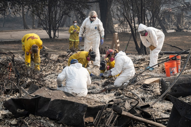 Rescue teams search for human remains in the rubble of the Camp Fire in Paradise, California on Friday.