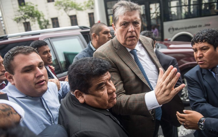 Former Peruvian president Alan Garcia arrives at the prosecutor's office in Lima on Nov. 15, 2018.
