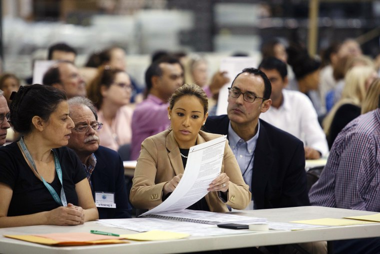 Volunteers look at ballots during a hand recount at the Supervisor of Elections Service Center in Palm Beach, Florida, on Sunday.