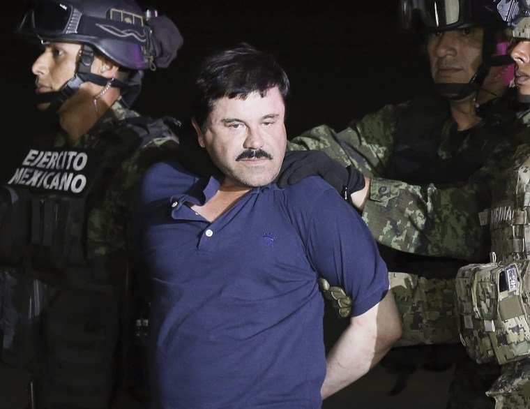 """Joaquin """"El Chapo"""" Guzman is escorted by authorities after his detention in Mexico City"""