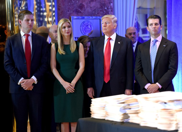 Then President-elect Donald Trump stands with his children Eric, left, Ivanka and Donald Jr. at Trump Tower in New York on Jan. 11, 2017.