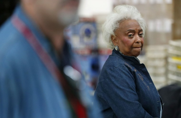 Image: Broward County Supervisor of Elections Brenda Snipes watches as Joe D'Alessandro speaks to members of the media after a hand recount