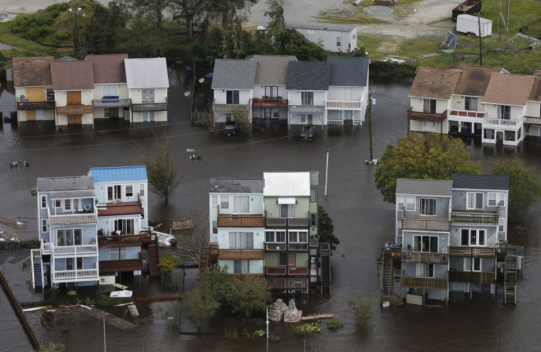 Homes along the New River are flooded after Hurricane Florence moved through Jacksonville, North Carolina, on Sept. 16, 2018.
