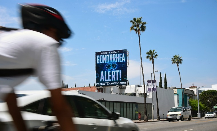 An AIDS Healthcare Foundation (AHF) billboard warning of a drug resistant gonorrhea on Sunset Boulevard