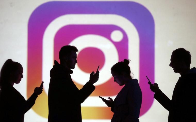 Silhouettes next to an Instagram logo.