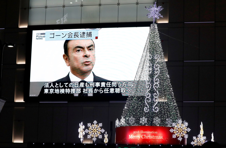 Image: A street monitor showing a news report about arrest of Nissan Chairman Carlos Ghosn in Tokyo